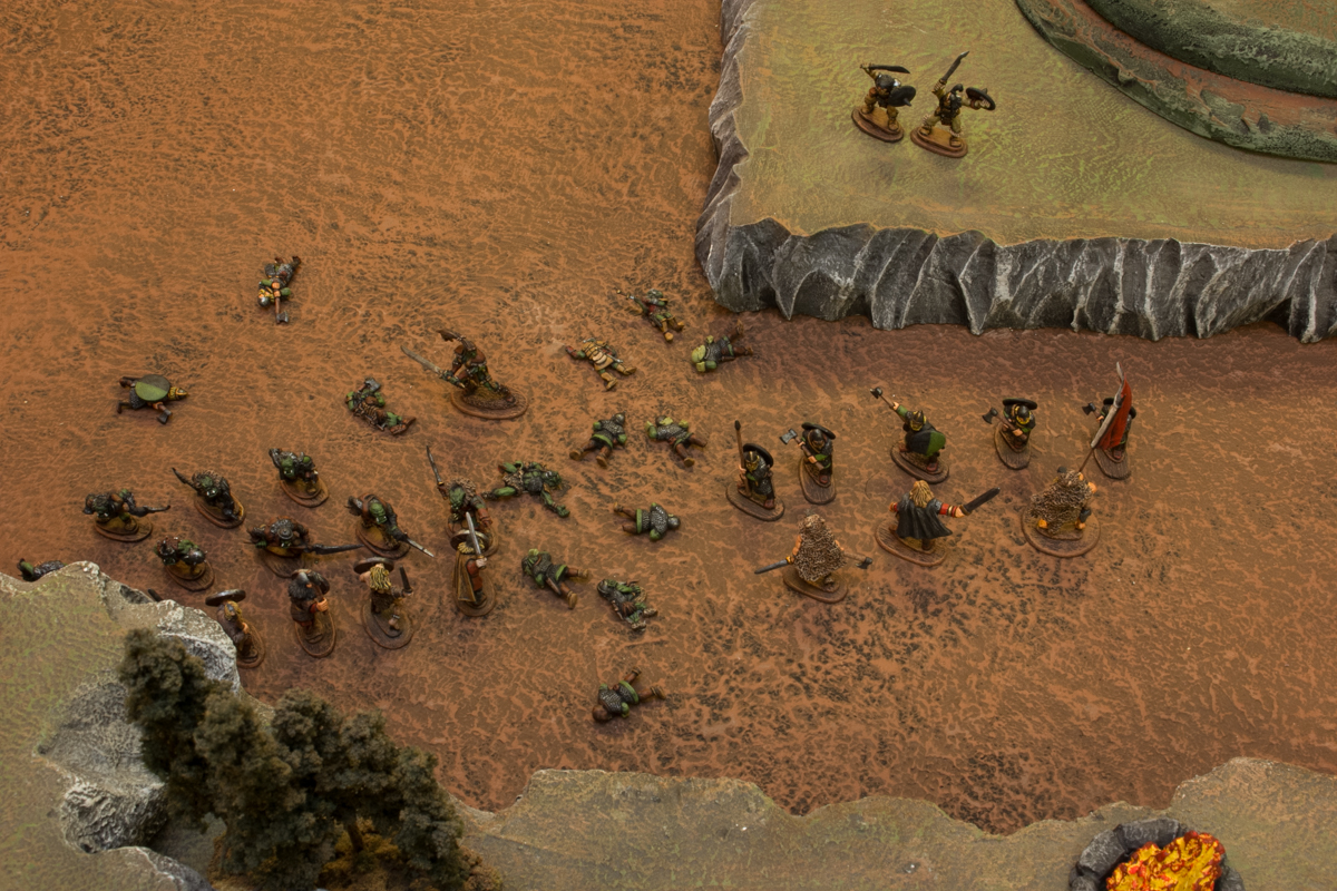 The orc reavers overpowered the lightly armored bonders, while the Gautrian Guardsmen stepped over the fallen orcs and hewed at Valgar and the berserks.