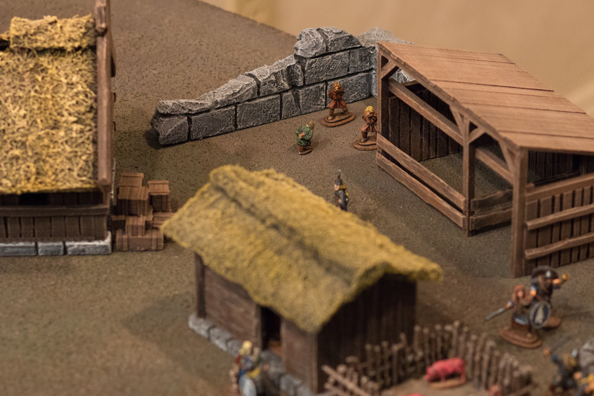 The captured bandits were taken behind the stable to be interrogated.