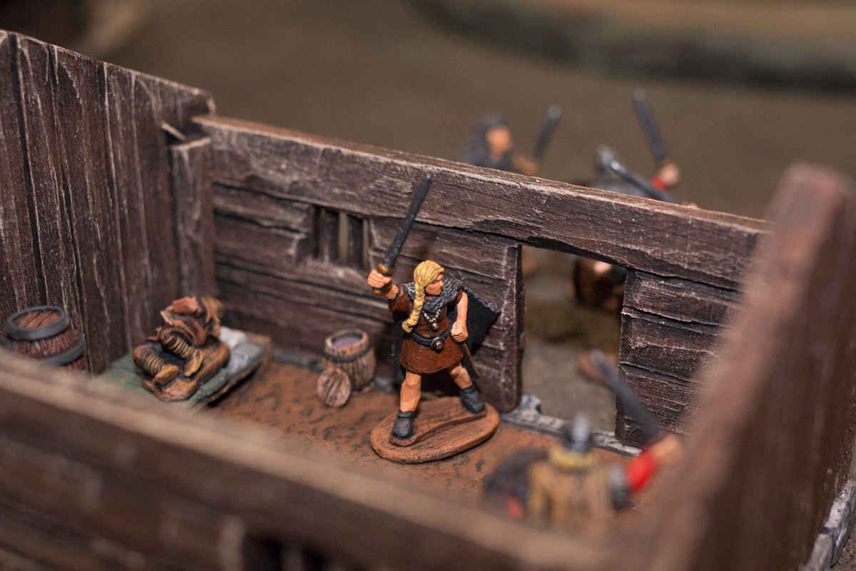 The fight raged outside the door, leaving Aedelfrid stuck in the cabin.